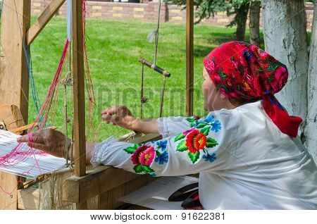 Belorussian Craftswoman Works At The Loom