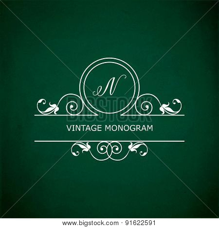 Monogram of the letter N, in retro floral style on green chalkboard background.