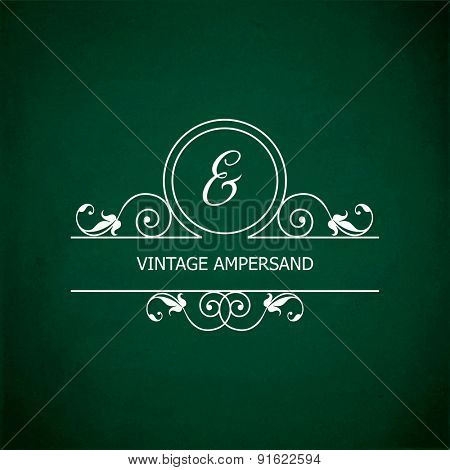 Monogram of the ampersand &, in retro floral style on green chalkboard background.