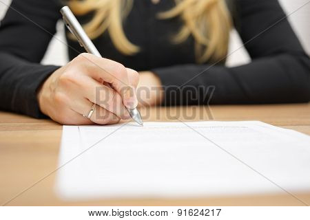 Woman With Black Shirt Is Signing Legal Document