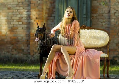 Attractive Woman In Peach Dress With Mastiff