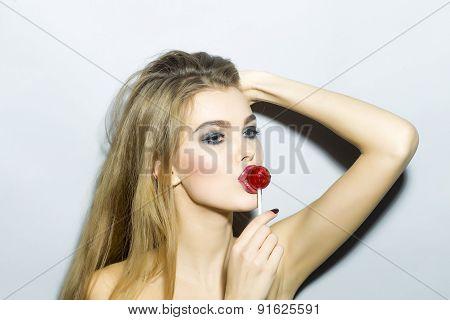 Pretty Blonde Girl Portrait With Sugar Candy