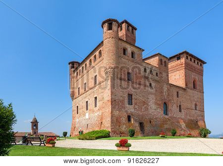 Medieval castle under blue sky in Piedmont, Northern Italy.