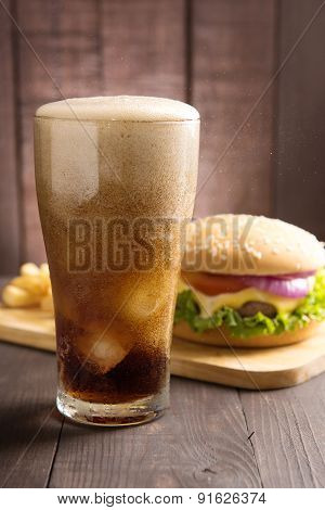 Cola With Bbq Hamburgers On Wooden Background.