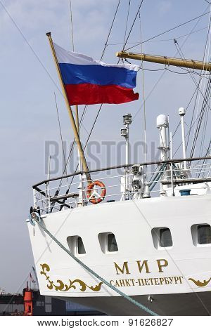The Russian Flag At The Stern Of The Windjammer Mir