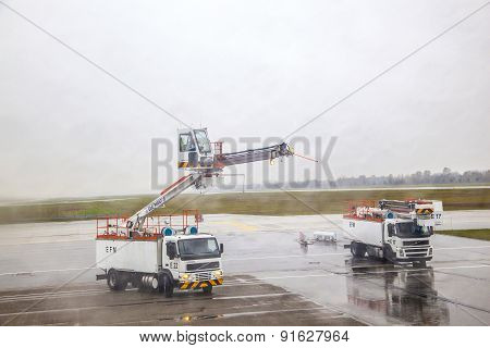 Deicing Truck Deices A Plane Before Take Off