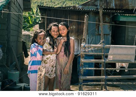 Smiling Cute Young Girls In Slum, Indonesia