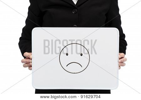 businesswoman holding whiteboard with unhappiness concept d