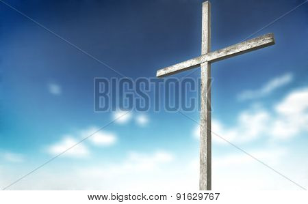 One wooden cross on blured background