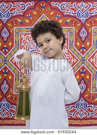 Happy Smiling Boy With Lantern Celebrating Ramadan
