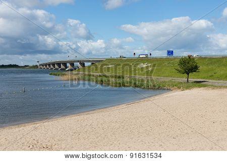 Dutch Beach And Concrete Bridge Between Emmeloord And Lelystad