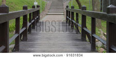 brown bridge in park