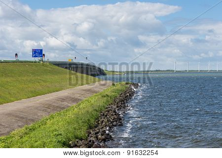 Dike With Concrete Bridge Of Dutch Highway Between Emmeloord And Lelystad