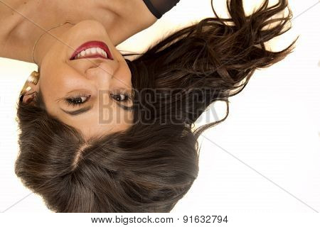 Portrait Of A Brunette Woman Laying Down Smiling Looking Up
