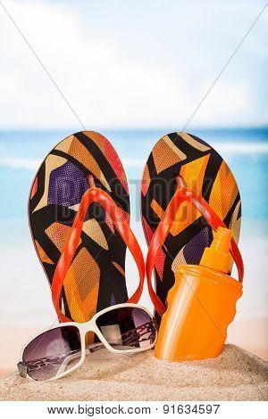 Slippers, sunblock and sunglasses