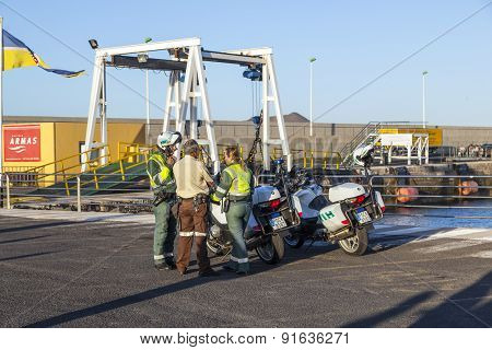 Spanish Policemen With Motor Bikes  Watches The Arrival Of The Ferry