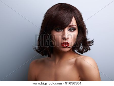 Sexy Makeup Woman With Short Black Hair Style And Red Lipstick