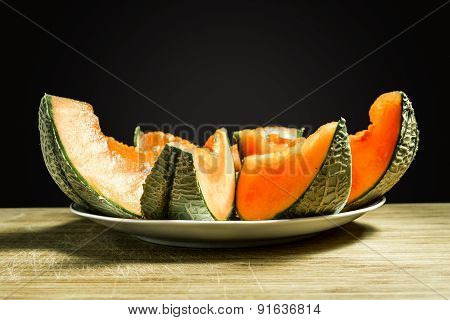 Slices Of Orange Melon Lies On The Plate