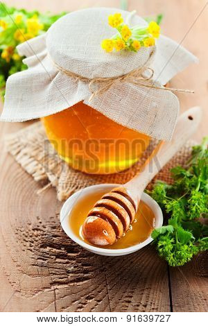Pot Of Honey And Wooden Stick