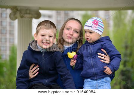 Mother With Two Children On A Walk In  Gazebo