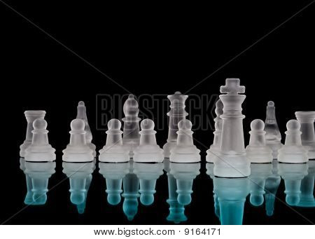 King And Chess Pieces With Reflection