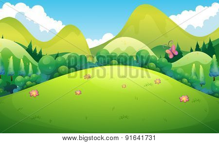 Green field with hills and trees in the back
