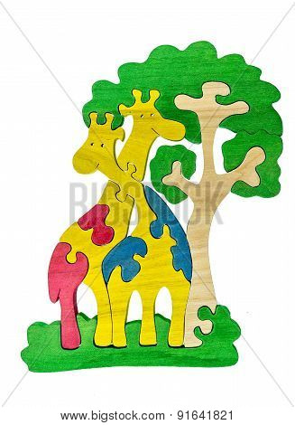 Colorful wooden puzzle in giraffes shape on isolated background