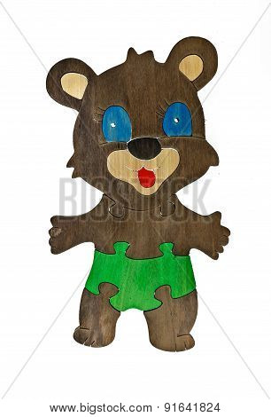 Colorful wooden puzzle in bear shape on isolated background