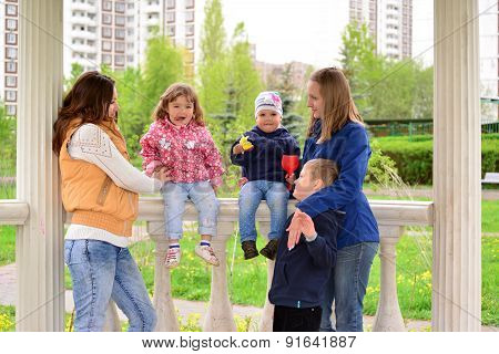 Two Mothers With Children On The Walk In  Gazebo