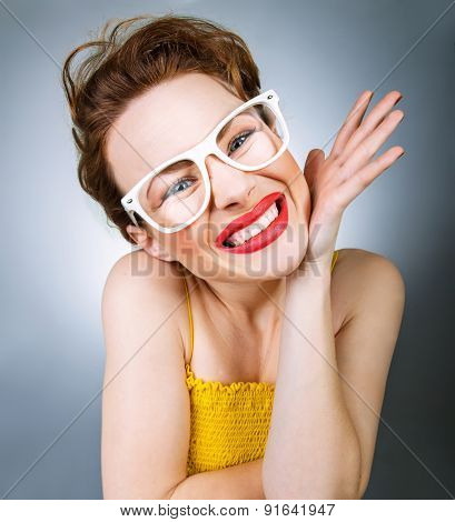 Close-up Portrait Of Young Woman In Funny Glasses With Annoyed Grimace