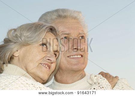 Senior couple on sky background