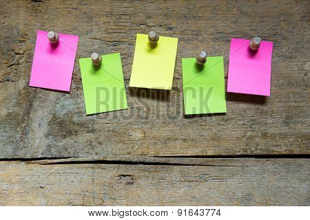 Five Blank Sticky Notes On Wooden Wall