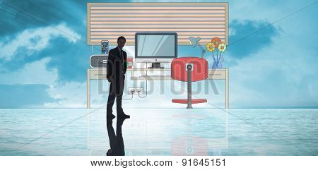 Businessman standing against sunrise over magical sea