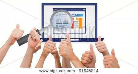 Group of hands giving thumbs up against magnifying glass over laptop