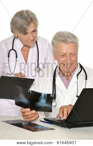 Doctors at the table on white background