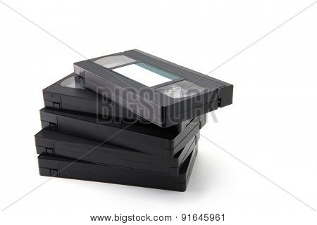 VHS Video cassette tapes stacked, isolated on white. blank label.