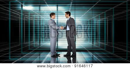 Businessmen shaking hands against abstract technology background