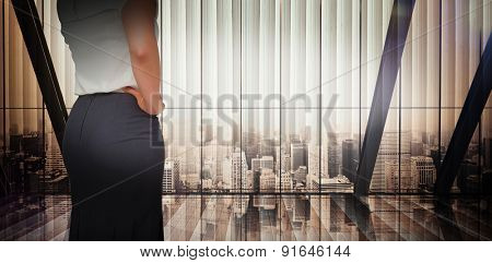 Businesswoman thinking against room with large window looking on city