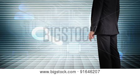 Businessman standing against grey shutters