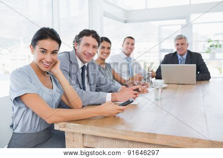 Smiling business team on a meeting in the office
