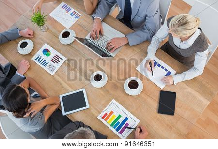 Business team discussing the graphs in the office