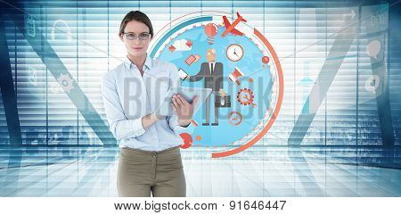 Businesswoman using tablet pc against room with large window looking on city