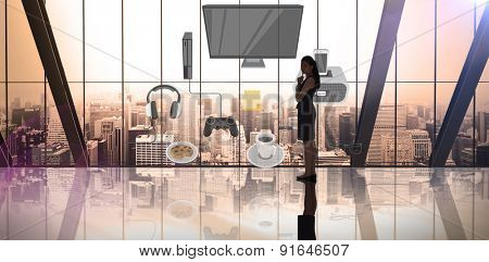 Thinking businesswoman against room with large window looking on city