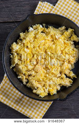 Scrambled Eggs In Vintage Frying Iron Pan, Overhead View