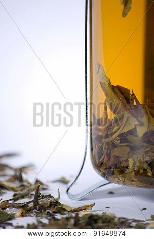 Close-up of teapot with green tea