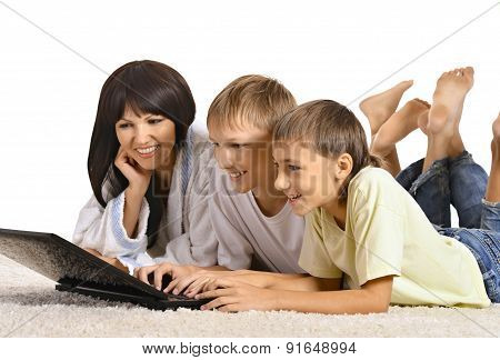 Friendly family resting with laptop