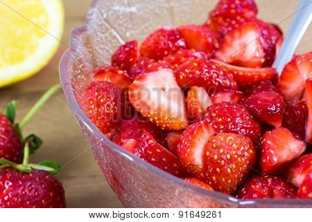 Close Up Of A Cup Of Sliced Strawberries With Lemon