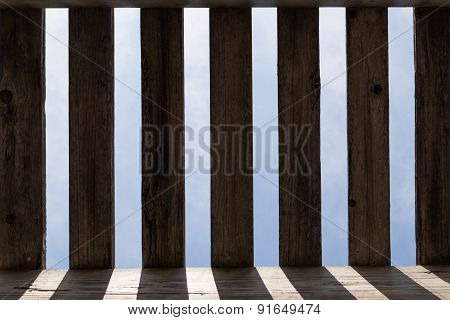 Wooden planks casting shadows