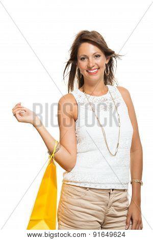 Happy Woman Raising Colored Shopping Bag