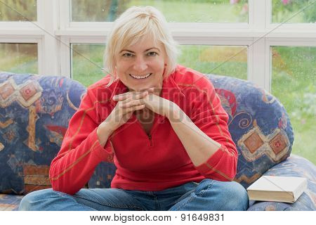 Blonde Middle-aged Woman Is Smiling To The Camera